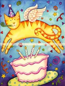 Cat jumping over a birthday cake